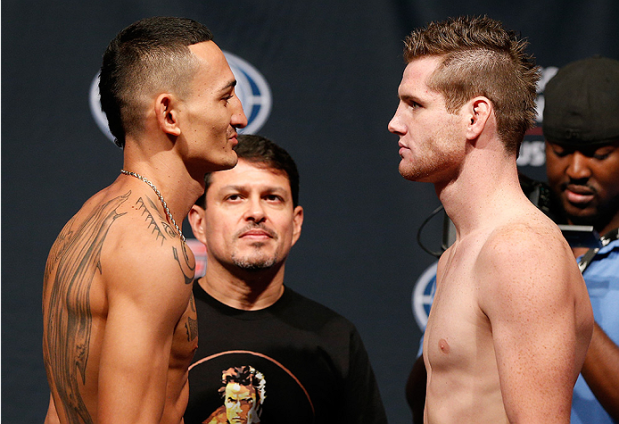 Opponents Max Holloway and Clay Collard face off during the UFC Fight Night weigh-in at the BOK Center on August 22, 2014 in Tulsa, Oklahoma. (Photo by Josh Hedges/Zuffa LLC/Zuffa LLC via Getty Images)
